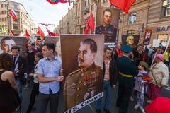 Deelnemers van Onsterfelijk Regiment - internationale openbare actie, die in Rusland plaatsvindt Stock Afbeelding