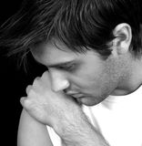 Deep. Young male in deep thought Stock Images