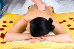 Deep back massage woman Stock Photo