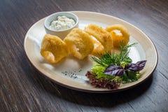 Deep batter fried squid rings calamari. In plate Royalty Free Stock Image