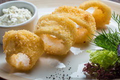 Deep batter fried squid rings calamari. In plate Royalty Free Stock Images