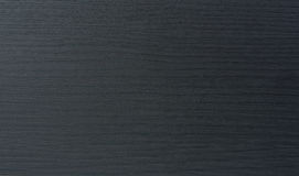 Deep black wood laminate material Royalty Free Stock Images