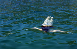 Diving in the sea. Girl diving in the Mediterranean sea Stock Image