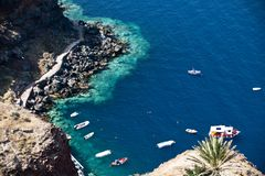 Deep blue Aegean Sea. With clear water and colourful boat Royalty Free Stock Photo