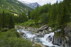 Deep blue Alpes. Cogne - village in Gran Paradiso Park Royalty Free Stock Image