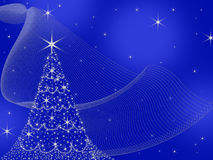 Deep Blue Christmas Background with Glitzy decorated Tree Stock Photos