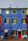Deep blue color house in Burano in the municipality of Venice in Italy Royalty Free Stock Image