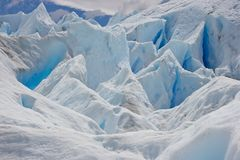 Blue ice on glacier in Chile national park royalty free stock image