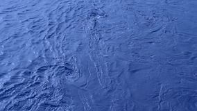 A Deep Blue Coloured Whirlpool In The Water stock video