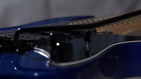 Deep Blue Electric Guitar Rotate on a Dark Background stock footage
