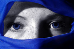 Deep Blue Eyes. Close up of woman with blue eyes (selective colouring Stock Image