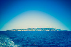 Deep blue filtered vignetted panorama view of Argentario royalty free stock images
