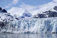 Deep Blue Glacier. The view of the blue glacier with mountains in a background in Glacier Bay national park, Alaska stock image