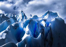 Deep Blue. Intense light coming out from the glacier Royalty Free Stock Photo