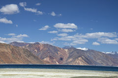 Deep blue lake and desert hills view Royalty Free Stock Images