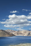 Deep blue mountain lake and desert hills Stock Image