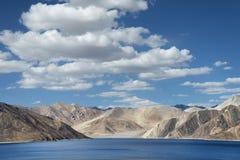 Deep blue mountain lake among hills Royalty Free Stock Photo