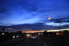 Deep blue night car road sky Stock Photography