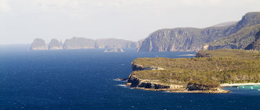 Deep Blue Ocean and Cliffs. Rough rocky headlands and a deep blue sea stock photos