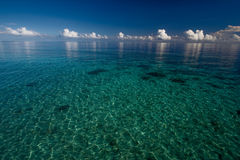 Deep blue ocean and clouds Stock Images