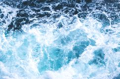 Deep Blue Ominous Ocean Water Background. Sea Ocean wave top view texture pattern for water nature background royalty free stock photography