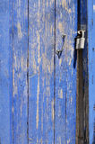 Deep blue rusty wicket door with metal handle and lock Stock Photo