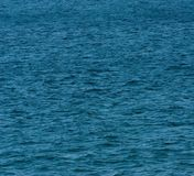 Deep Blue Sea. Blue Green sea , with gentle waves, uk royalty free stock photos
