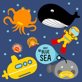 DEEP BLUE SEA. Aquanaut travel in the sea by yellow submarine discover giant whale, orange octopus, pufferfish Royalty Free Stock Photography