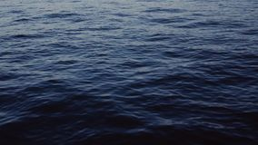 Deep blue sea. Calm waves, slow motion. Natural beauty, water. No people around. Cool atmosphere.