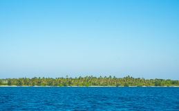 A deep blue sea with island in distance with medium water wave ripple royalty free stock image