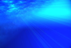 Deep blue sea view. Deep blue sea, view form beneath the water (ray lights Royalty Free Stock Image