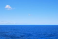 Deep blue sea waters and clear sky Stock Photography