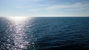 Deep blue seas sunrise shimmering on water surface calming peaceful water horizon stock video