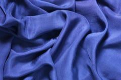 Deep blue silk background Stock Photos