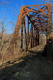 Deep blue skies over a rusted train bridge Stock Photography