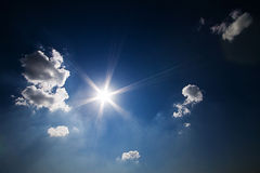 Deep Blue Sky. The Sun with archers on the deep blue sky with clouds royalty free stock photo
