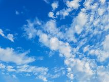 Deep blue sky back ground. With white cloud royalty free stock photo