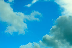 Deep blue sky background with white clouds Stock Photography