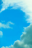 Deep blue sky background with white clouds Stock Image
