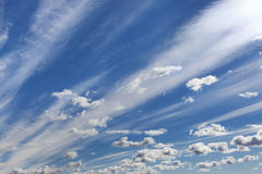 Deep blue sky with clouds. Stock Images