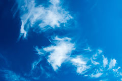 Deep blue sky with fluffy clouds Royalty Free Stock Photo