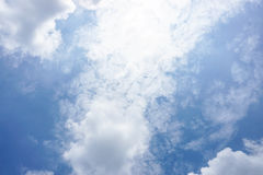 Deep blue sky with fluffy clouds. And sunlight Royalty Free Stock Photos