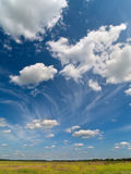 Deep blue sky with green field. Deep blue sky with white clouds Stock Photos