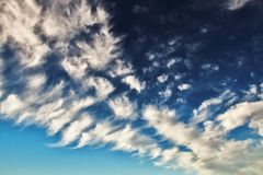 Deep blue sky with many small clouds Stock Photos