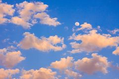 Blue sky with clouds and moon Stock Image