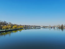 Deep blue sky over river Stock Photography
