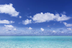 Deep blue sky over the turquoise sea. Deep blue sky with white clouds over turquoise sea Royalty Free Stock Photo