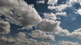 Deep blue sky with running clouds over, uhd 4k. Timelapse stock footage