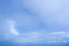 Deep blue sky with some white clouds. On midday Stock Photos