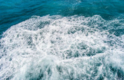Deep blue stormy sea water surface with white foam and waves pattern. Background photo texture Royalty Free Stock Images